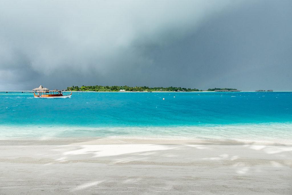 Sunshine and cloud on a Maldivian beach resort island